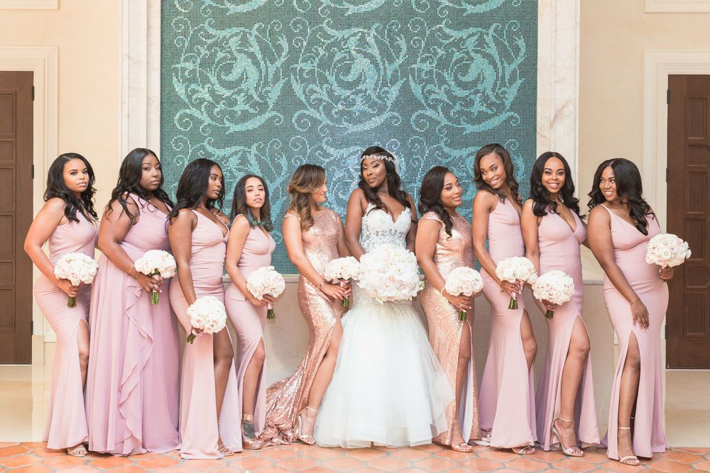 Bridesmaids pose for a fun and sassy photo at the Four Seasons captured by top Orlando wedding photographer