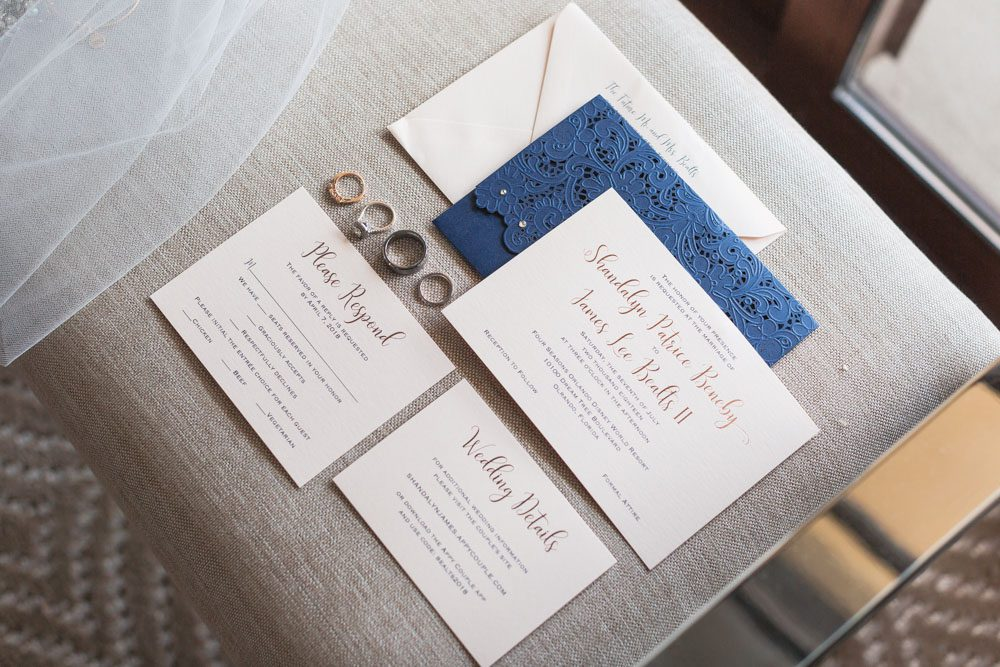 Invitation suite with navy blue and cream for a wedding at the Four Seasons captured by top Orlando wedding photographer and videographer