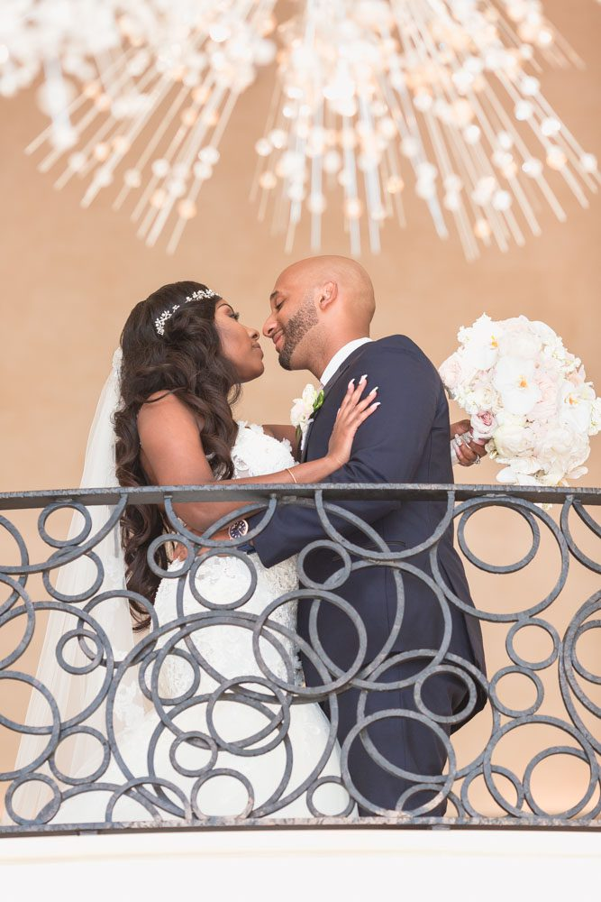 Romantic portrait of the bride and groom at the Four Seasons at Walt Disney World captured by top photography team in Orlando