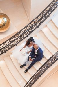 Couples portrait on the stairs at the Four Seasons resort in Orlando captured by top photographer in Central Florida