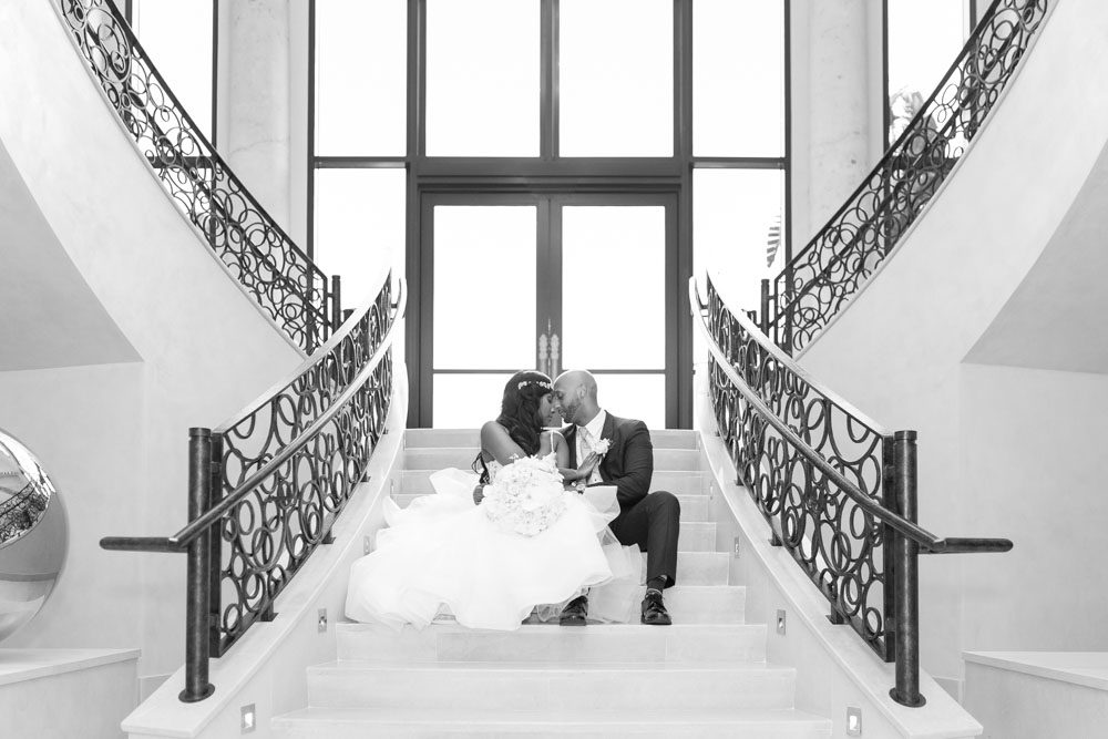 Couples portrait on the stairs at the Four Seasons resort in Orlando captured by top Disney photographer