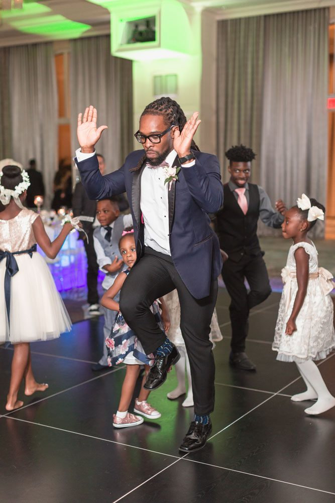 Fun and candid wedding reception dancing photos captured by top Orlando wedding photographer at the Four Seasons resort at Disney