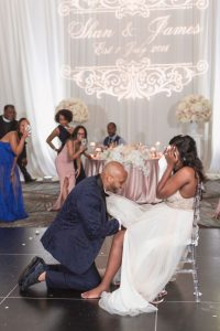 Groom retrieves the garter during his Orlando wedding day at the Four Seasons resort