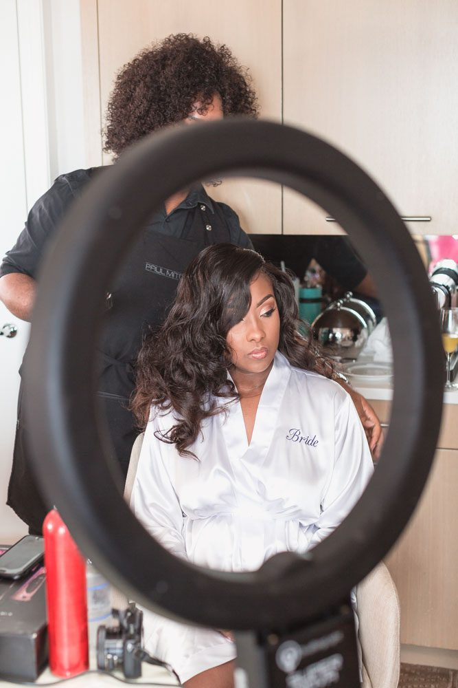 Bride getting her hair and makeup done for her Disney Four Seasons wedding day