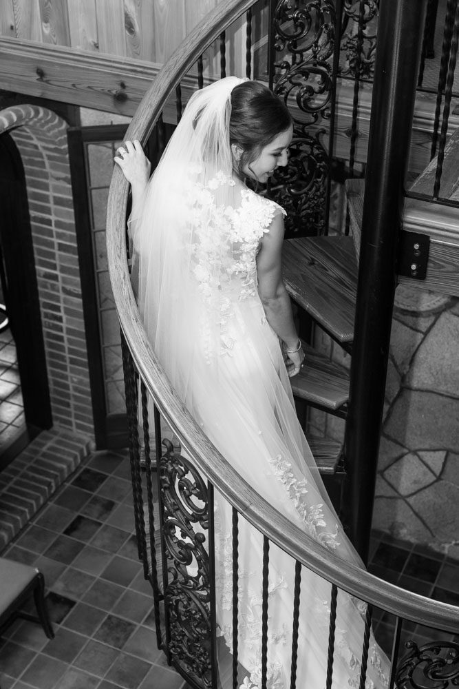 Portrait of the bride on the spiral staircase at the Estate on the Halifax venue captured by top Orlando photography team