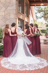 Portrait of the bride and bridesmaids in burgundy red dresses at Estate on the Halifax wedding east of Orlando