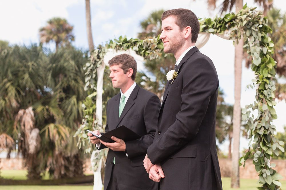 Groom sees bride down the aisle at their outdoor wedding at the Estate on the Halifax east of Orlando