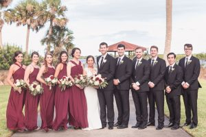 Photo of the wedding party featuring bridesmaids in wine red burgundy dresses captured by Orlando photographer