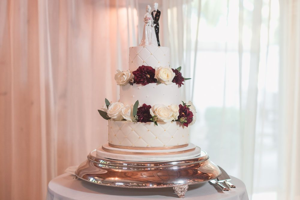 Three tier cake with flowers for Estate at the Halifax wedding in Port Orange Florida