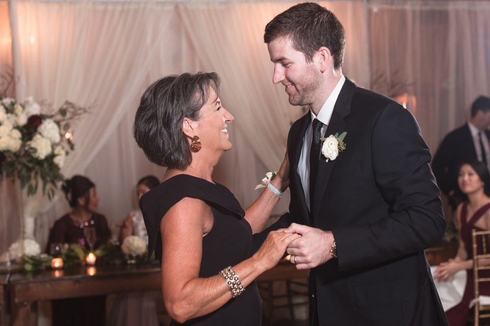 Photo of the groom sharing a first dance with mom during their Estate on the Halifax wedding reception near Orlando