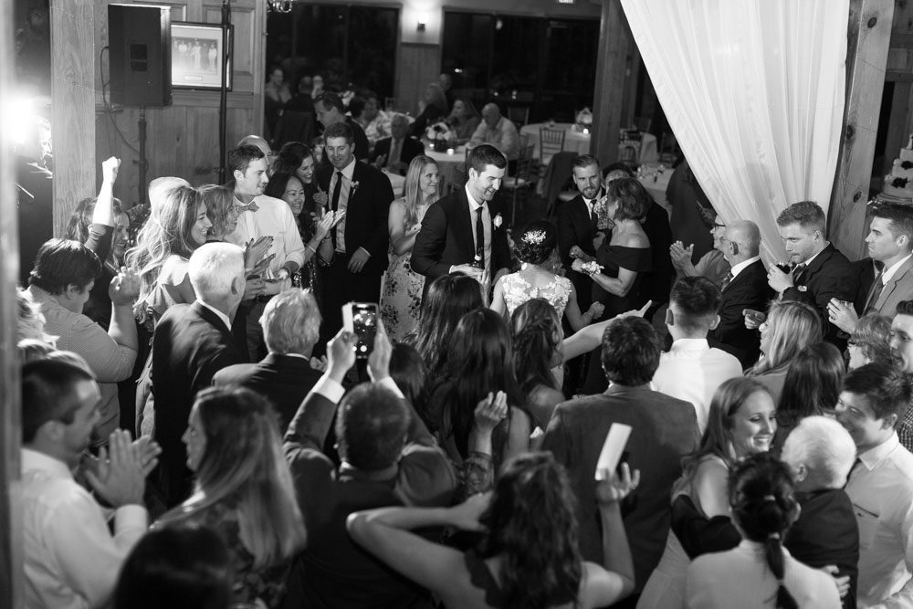 Black and white photo of the guests dancing during an Estate on the Halifax wedding reception