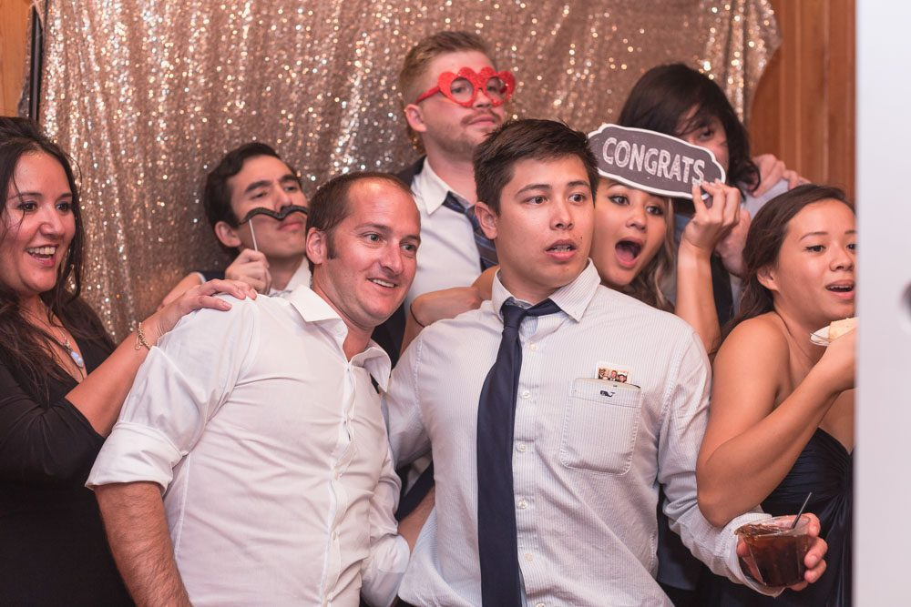 Fun candid photo in the photo booth during an Orlando wedding reception