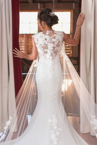 Bride shows off her wedding dress at the Estate on the Halifax venue in Port Orange east of Orlando