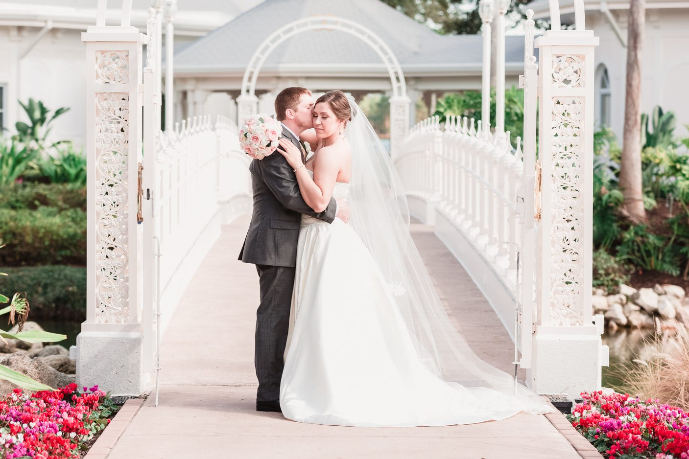 Disney bride and groom in front of the wedding pavilion in Orlando