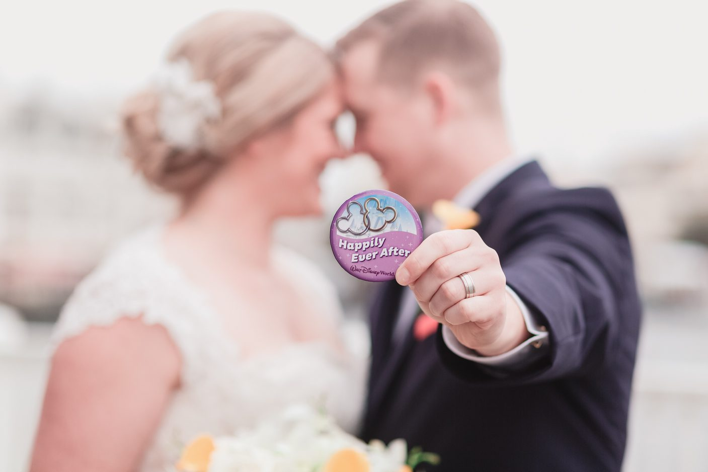 Happily ever after pin showing the wedding ring after a disney wedding in orlando