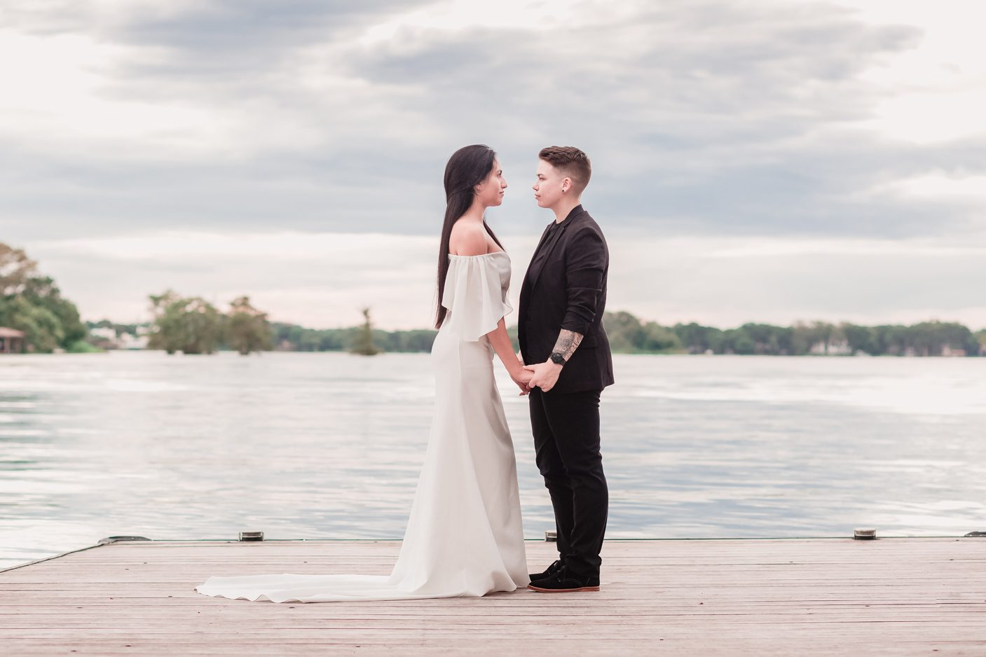 Two brides on their wedding day in Orlando park at sunset captured by top photographer