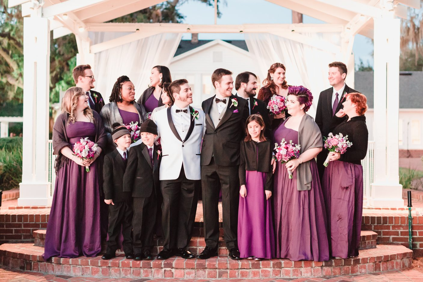Wedding party at a gay wedding at Cypress Grove Estate house captured by top Orlando LGBT wedding photographer