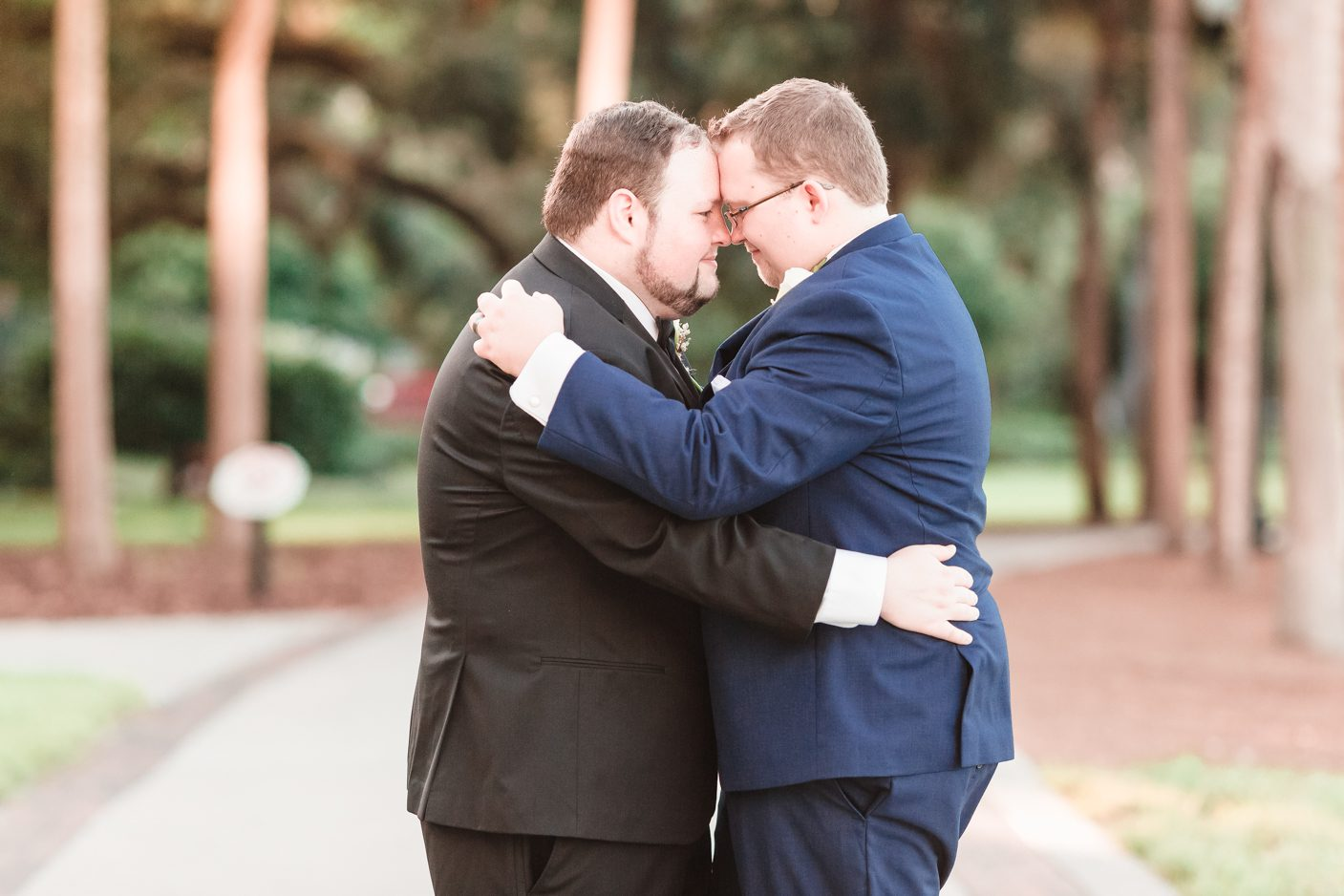Two grooms embrace during their gay wedding at Lake Eola in downtown Orlando