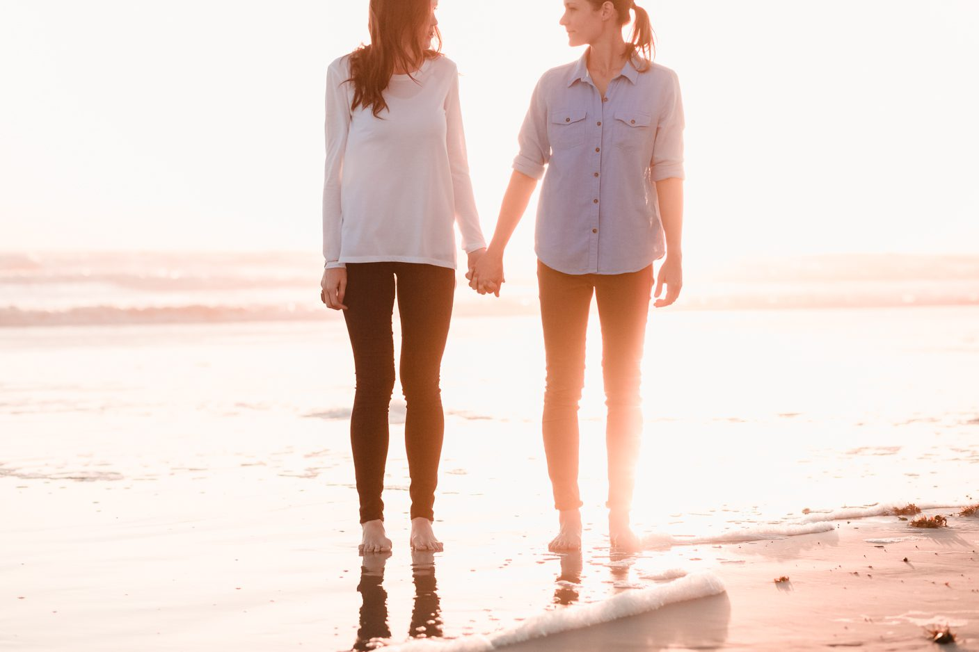 Same-sex lesbian engagement session on the beach at sunset captured by top Orlando photographer