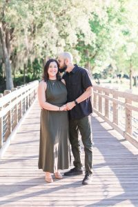 Candid and romantic engagement session at sunset in Celebration captured by top Orlando photographers