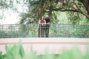 Romantic engagement photo on a bridge in Celebration Florida captured by top Orlando photographer