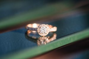 Close up of a gold round halo engagement ring during Orlando photography session