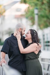 Romantic engagement session on the waterfront dock in Celebration captured by top Orlando wedding photographer