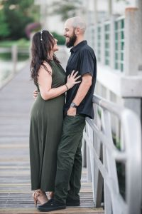 Romantic engagement session on the lakefront pier in Celebration captured by top Orlando wedding and engagement photographer