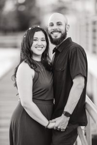 Black and white engagement session on the lakefront pier in Celebration captured by top Orlando wedding and engagement photographer