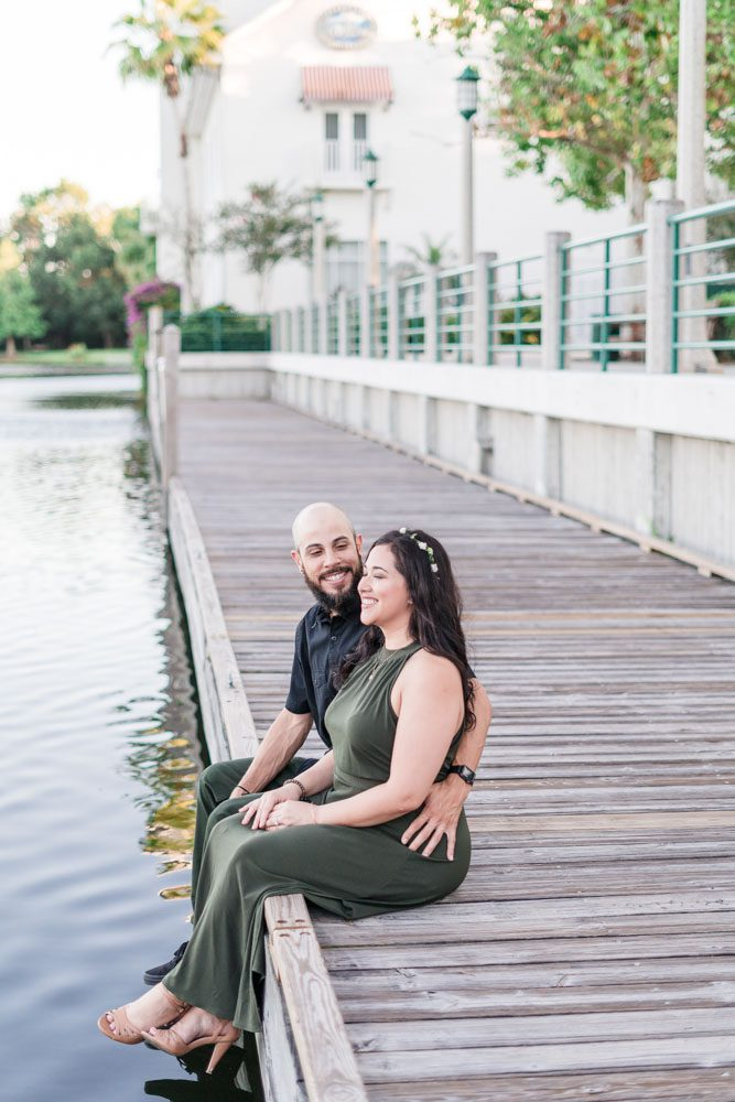 Fun engagement session on the lakefront pier in Celebration dock captured by top Orlando engagement photography team