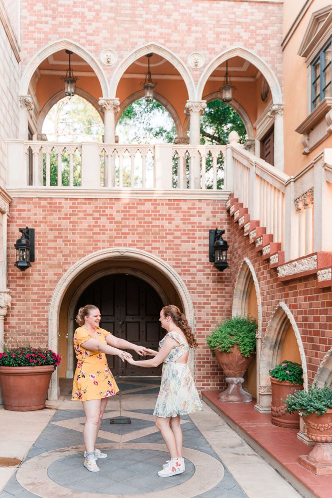 Fun and playful engagement session in Italy at Epcot in Disney captured by top Orlando gay wedding and engagement photographer