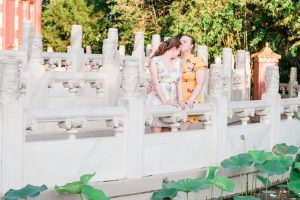 Romantic lesbian engagement photo in China at Epcot captured by top Orlando photographer for gay weddings