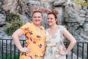 Romantic and fun same-sex engagement session at Disney's Epcot Park captured by top Orlando proposal and engagement photographer