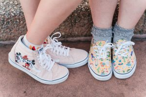 Close up of the couples Disney inspired sneakers during their engagement session at Epcot in Orlando