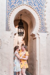 Romantic same-sex engagement session at Morocco in Epcot at Disney World captured by top Orlando gay wedding photographer