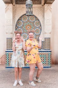 Fun and candid same-sex engagement session at Morocco in Epcot at Disney World captured by top Orlando gay wedding photographer