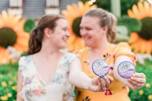 Romantic lesbian engagement session at Disney in Epcot during Flower and Garden Festival captured by top Orlando gay wedding photographer