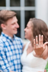 Surprise proposal photography at Disney resort showing off the engagement ring