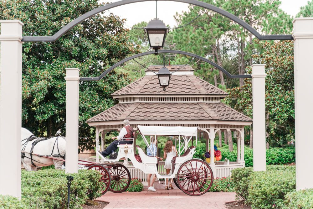 Horse carriage ride turns into a surprise proposal captured by top Orlando engagement photographer at Disney