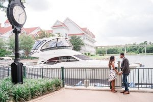 Orlando photographers capture a surprise proposal at the Grand Floridian resort in front of the yacht at Disney