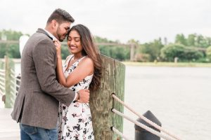 Candid and romantic engagement photo on the dock at the Grand Floridian captured by top Orlando engagement photography team