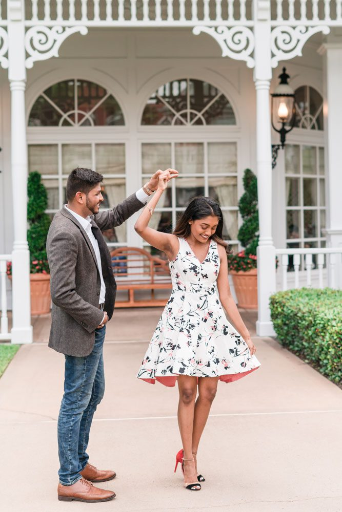 Fun twirling engagement photo at the Grand Floridian captured by top Orlando engagement photographers
