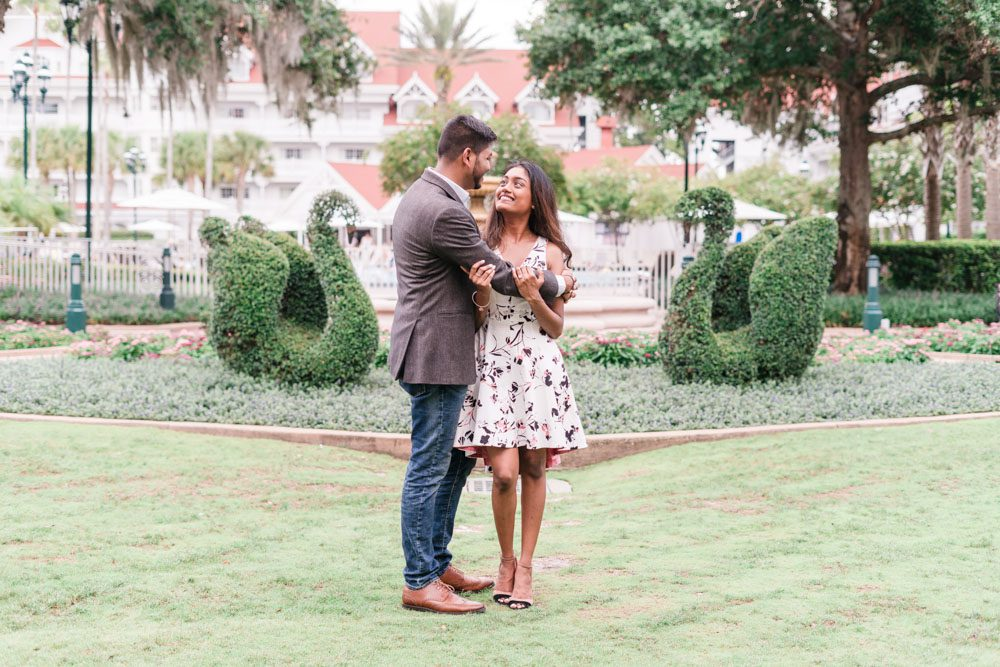 Sweet and romantic engagement portrait at the Grand Floridian following a surprise proposal captured by photographers in Orlando