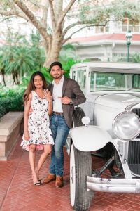 Fun engagement photo with a vintage car at the Grand Floridian Resort in Orlando, Florida