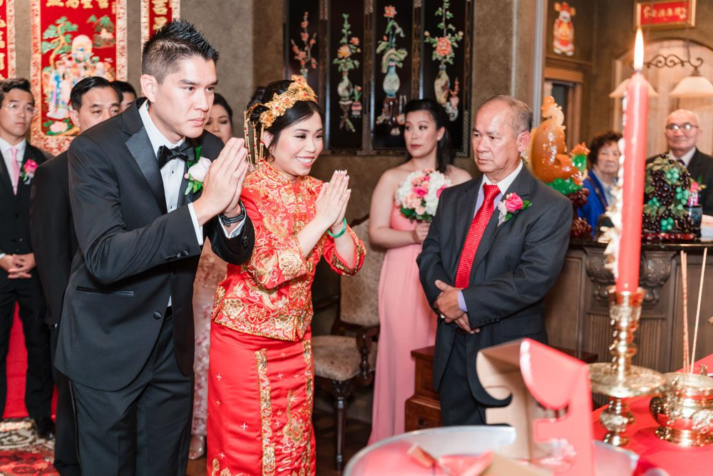 Bride & Groom participate in traditional Vietnamese tea ceremony during their wedding day