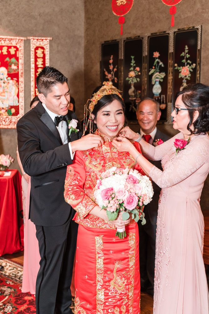Bride gets a gift during the Chinese and Vietnamese tea ceremony at her wedding day in Oklahoma City