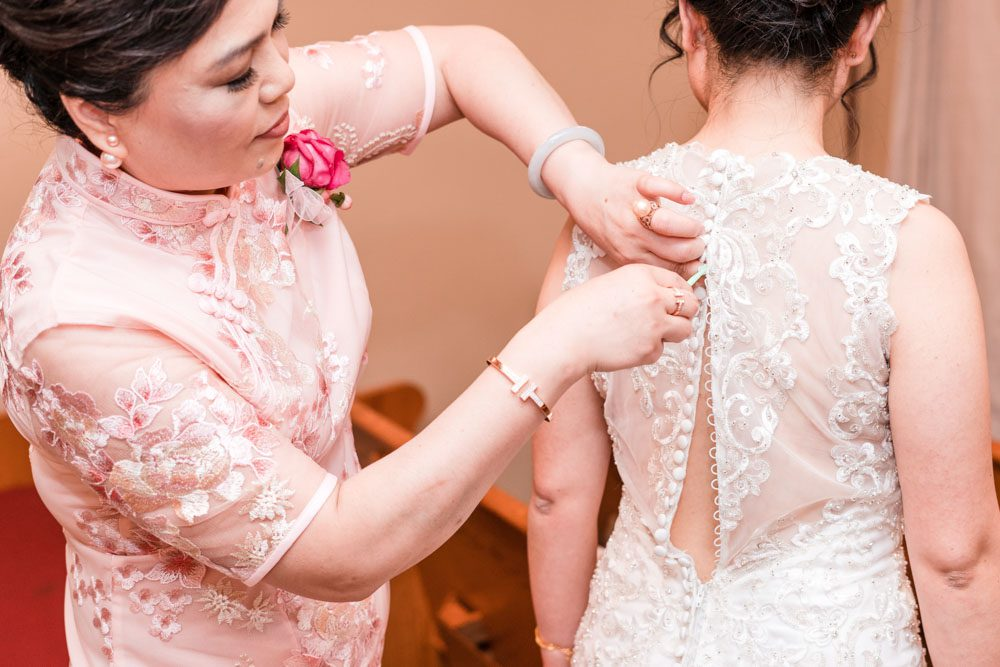 Bride getting ready for her wedding day in Oklahoma captured by photographers from Orlando