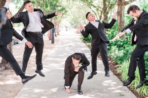 Fun portrait of the groom and his groomsman taken by top Orlando photography team in Oklahoma City