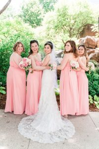 Bridesmaids wearing blush pink dresses with bride at Myriad Gardens in Oklahoma City