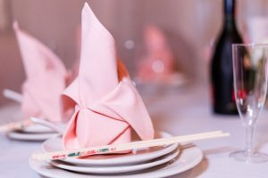 Close up of pink napkin and chop sticks on the reception table at Hy Palace in Oklahoma City